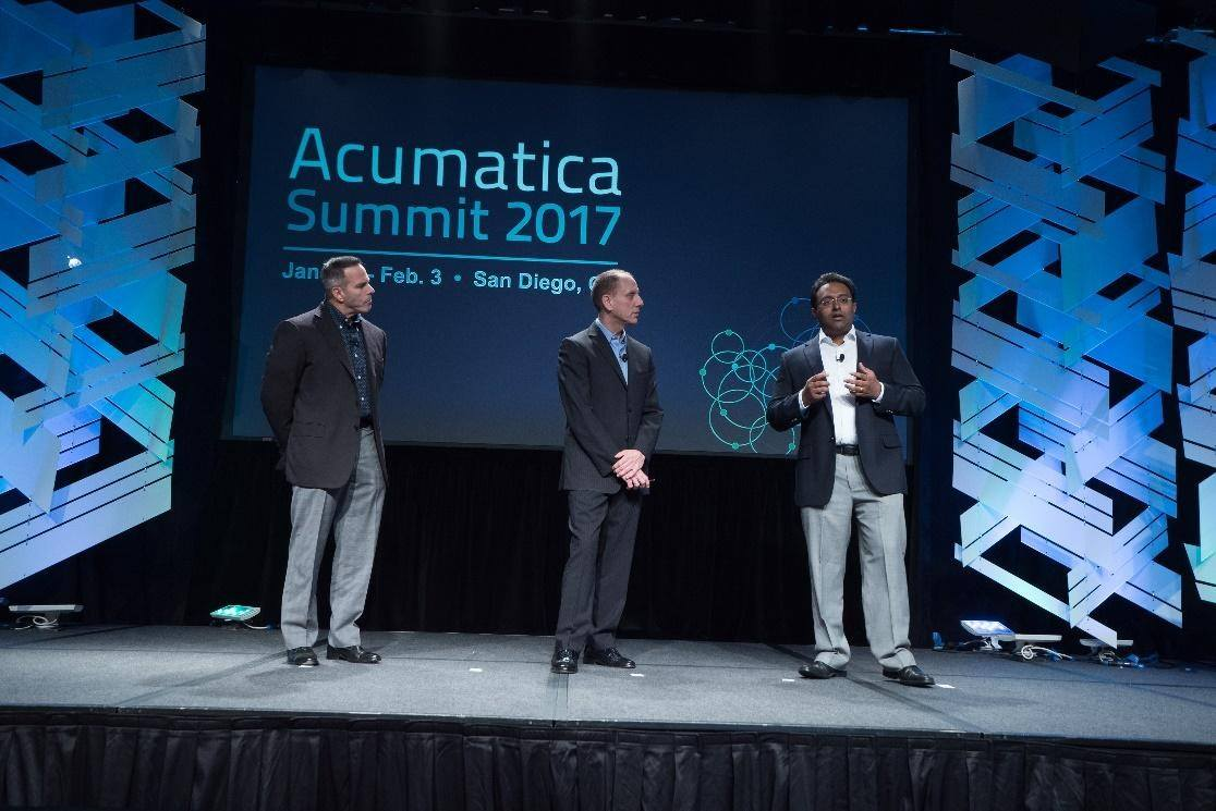 Acumatica CEO Jon Roskill is joined on stage by Kensium's Rahul Gedupudi and Magento's Gary Specter during the announcement of Acumatica Commerce Edition
