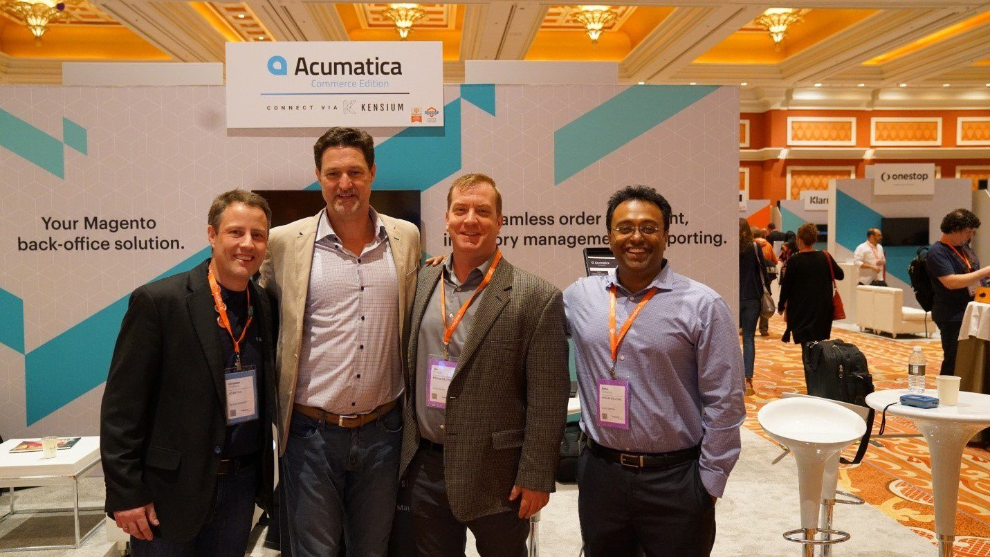 Acumatica's Christian Lindberg, Magento CEO Mark Lavelle, and Kensium Solutions' Jim Hruska and Rahul Gedupudi pose for a photo in front of our Marketplace booth on the final day of Imagine 2017.